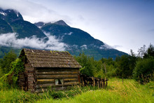Old, Abandoned Cabin In An Ove...