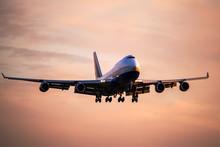 Large Passenger Airplane Landing At International Airport At Sunset.