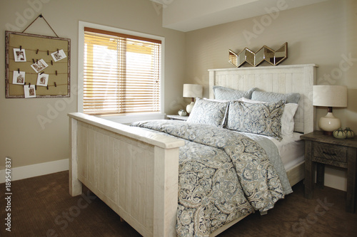 Traditional bedroom with white double bed.