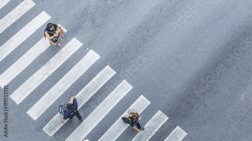 From the top view of people walk on street pedestrian crossroad in the city street with the motorcycle drives pass road ,bird eye view Canvas Print