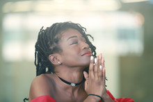 Pretty African Girl Folding Ha...