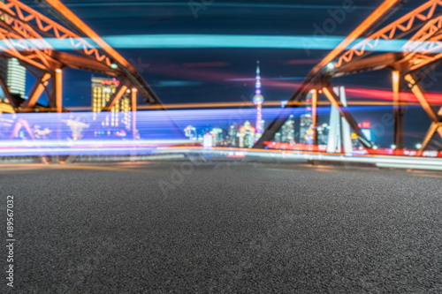 clean road on steel bridge with car light trails in shanghai Poster