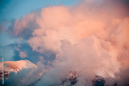 Foto op Plexiglas Hemel Sunset with dramatic clouds over Swan Mountains