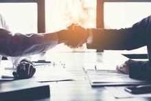 Business Partners Handshaking ...