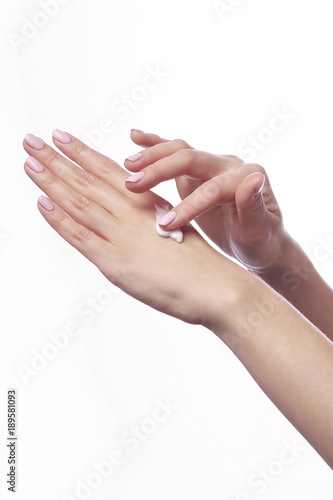Beautiful woman's hands with white cosmetic care cream