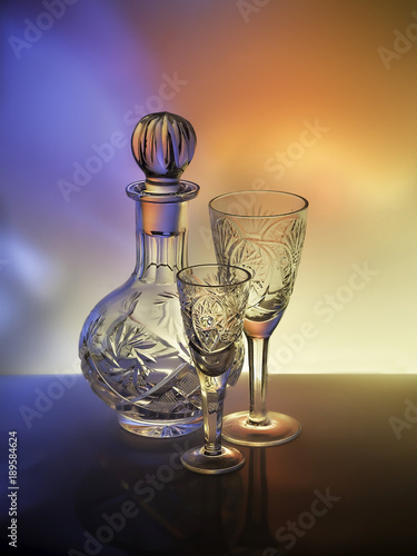The bright colors on crystal decanter and glasses