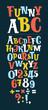 Cute funny childish alphabet on dark background.