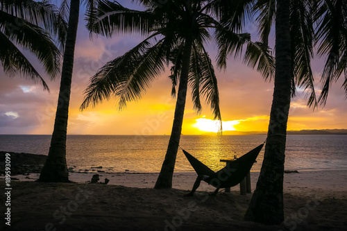 Photo  Man in Hammock on Sunset Paradise Beach - Siargao, Philippines