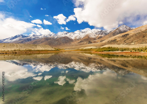 Foto auf Gartenposter Reflexion LEH, JAMMU & KASHMIR - INDIA - along the Indus Valley, right at the border with Pakistan and China, between monasteries, rivers, lakes, and blue skies