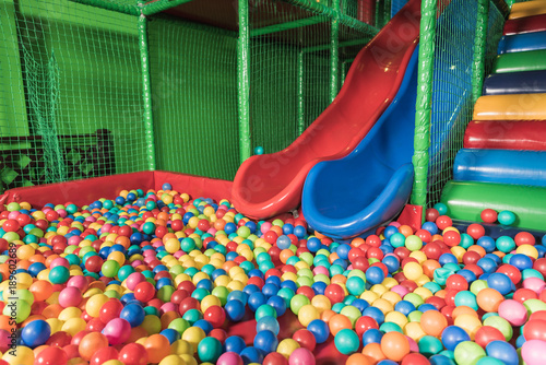 Foto op Plexiglas Fitness slides and pool with colorful balls in entertainment center