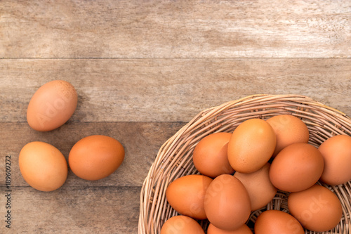 Group Of Chicken Eggs For Cook And Sale In Basket On Wooden Table