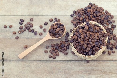 Top view of Coffee beans in weed basket with wooden spoon on
