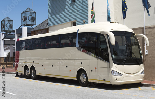Luxury tour bus with large wing mirrors
