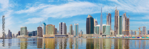 Dubai - The panorama with the new Canal and skyscrapers of Downtown Canvas Print