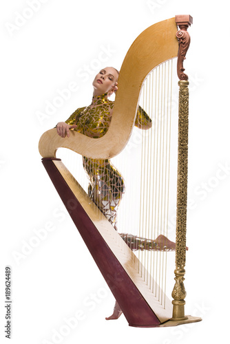 Fotografia Nude blonde with gold tape bodyart and a harp view