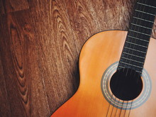 Acoustic Guitar Resting Agains...