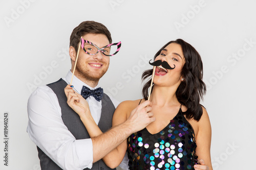 happy couple with party props having fun Wallpaper Mural