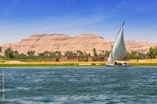 Spoed Foto op Canvas Egypte Falukas sailboat on the Nile river near Luxor, Egypt