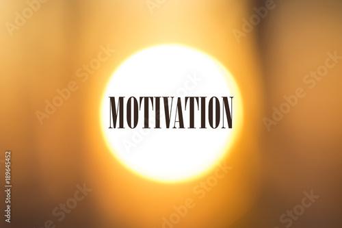 Motivation word. Motivational phrase on sunny background