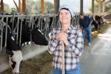 Female Farmer Posing On Backgr...