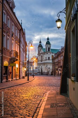 Fototapeta Pauline church of St. Spirit and Freta street at night on the old town in Warsaw, Poland obraz