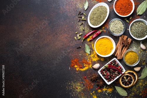 Obraz Set of Various spices on dark stone table. - fototapety do salonu