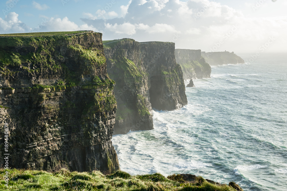 Fototapety, obrazy: The Cliffs of Moher, Irelands Most Visited Natural Tourist Attraction, are sea cliffs located at the southwestern edge of the Burren region in County Clare, Ireland.