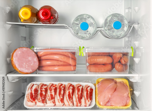 Refrigerator with fresh meat products, closeup