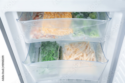 Frozen vegetables in refrigerator, closeup