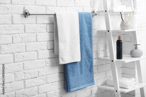 Vászonkép Clean towels on rack in bathroom