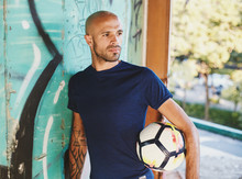 Portrait Mixed Race Football Player Who Practic With Soccer Ball In Abandoned Place