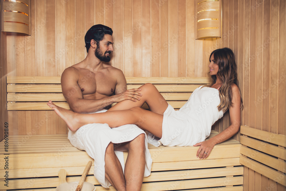 Fototapeta Beautiful couple relaxing in SPA sauna room
