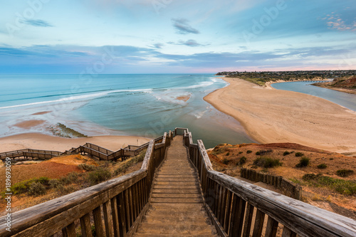 The wooden staircase leading down to the mouth of the Onkapringa river Port Noar Canvas Print