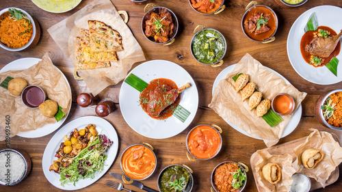 Valokuva  Assorted indian food set on wooden background