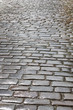 Antique wet cobblestone street. Rainy day. Vintage background