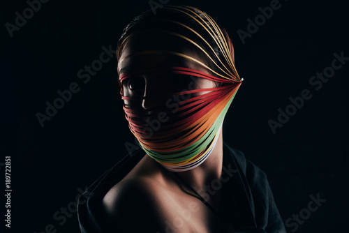 Fototapeta woman with colored quilling paper on head looking away isolated on black obraz na płótnie