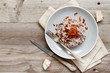 canvas print picture - Risotto with red radicchio and crispy bacon (speck)