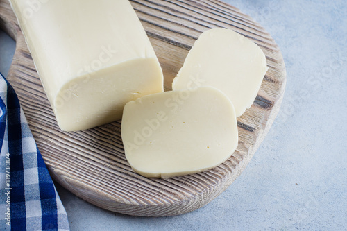 White mozzarella on blue concrete stone background table. Healthy Food Concept. Daily product. Copy space