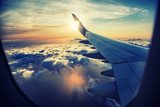 Fototapeta Na sufit - flying and traveling,  view from airplane window on the wing on sunset time