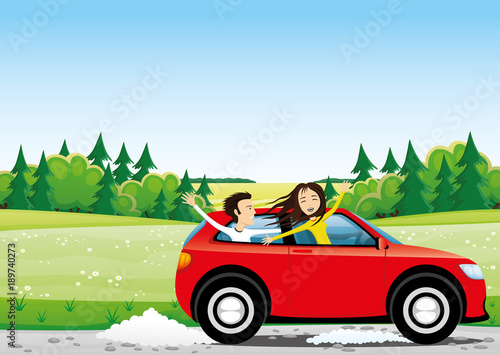 Cheerful young people in a red car on a road in the fields.