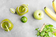 Green healty drink in mason jar with green apple, mint and lime on bright grey background. Vegetarian food concept. Detox. Text space