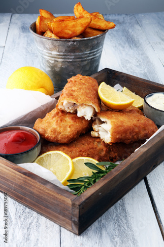 traditional British fish and chips with potato and lemon © beats_