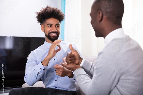 Fotografía  Two Happy Men Making Sign Language