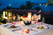canvas print picture - Romantic candlelight dinner luxury table setup for couple with beautiful light as background. Glasses of champagne and beautiful food presentation on table.. Concept for valentine's day  and date.