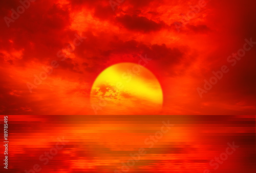 Tuinposter Rood An abstract landscape with sunrise over a slightly wavy surface of the sea