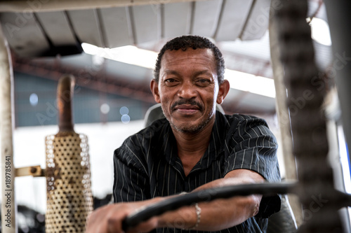 Fotografia  Worker on Forklift Looking at Camera