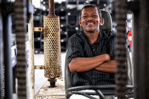 Fototapeta Worker on Forklift Looking at Camera obraz na płótnie