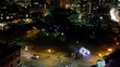 Grainy Static shot of a downtown Toronto Park at night in the winter, with street traffic