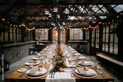 Set tables for fancy dinner in a green house - 189793843
