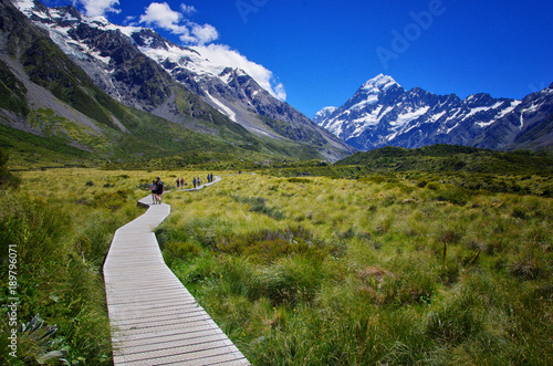 Valokuva  Beautiful landscape of walkway in the nature, mountains in the background